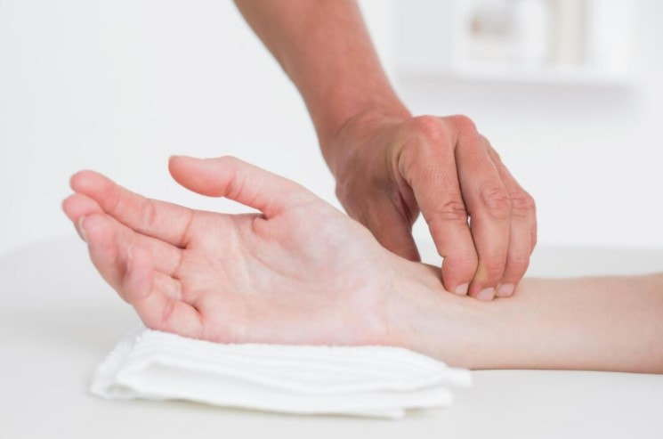 a trigger point massage to help relieve wrist pain